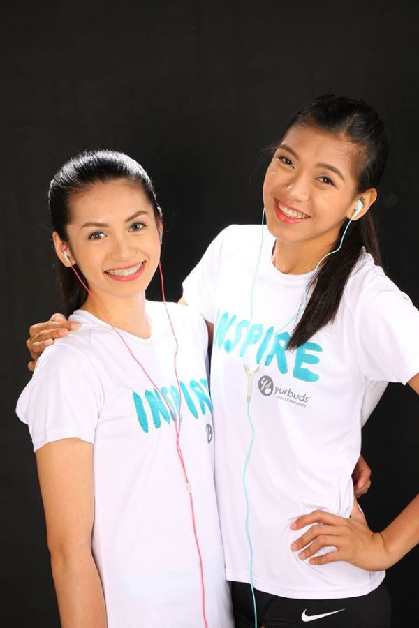 Alyssa Valdez (right), 2013 UAAP Volleyball MVP Player of Ateneo de Manila and her teammate Den Den Lazaro are happy to have yurbuds as their companion during breaks or warm ups before the game